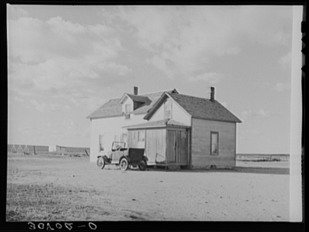 Farmhouse and old car. Williams County, North Dakota