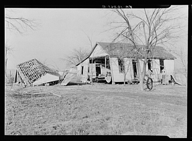 Farmhouse and outbuildings ruined by flood. Posey County, Indiana