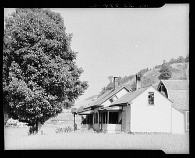 Farmhouse with slanting window. Windsor County, Vermont