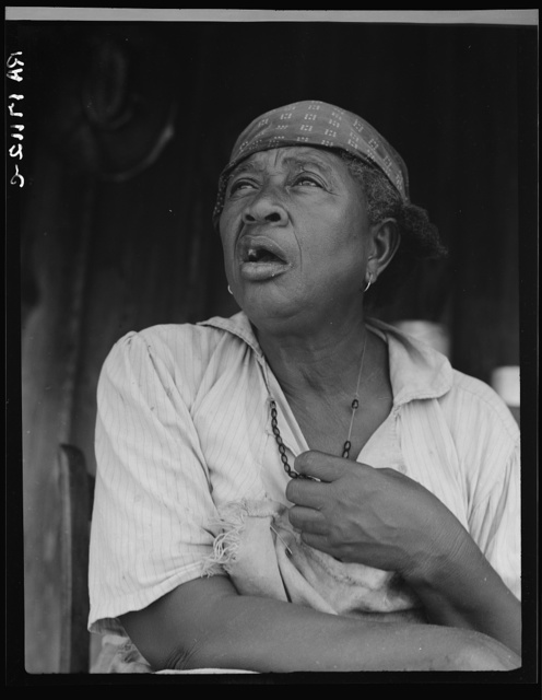 Fifty-seven year old sharecropper woman. Hinds County, Mississippi. Black beads hung between the breasts are good for heart trouble