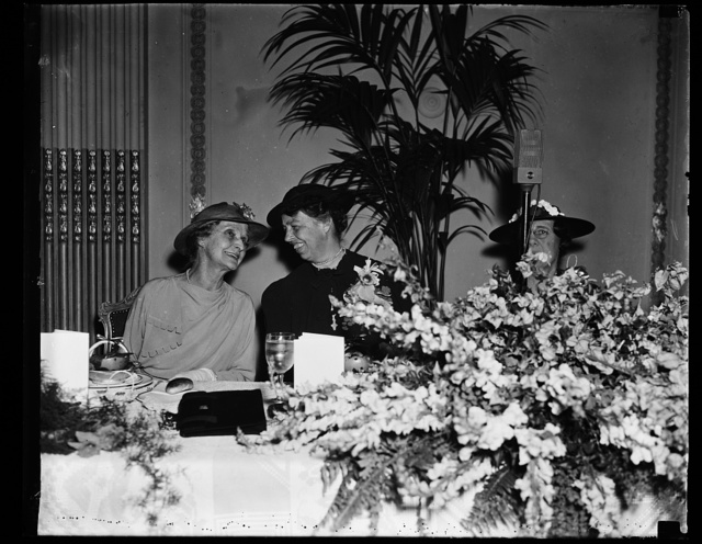 FIRST LADY AND WIFE OF CHIEF JUSTICE BREAKFAST TOGETHER. WASHINGTON, D.C. APRIL 22. BREAKFASTING TODAY AS GUESTS OF THE CONGRESSIONAL CLUB, MRS. ROOSEVELT AND MRS. CHARLES EVANS HUGHES, WIFE OF THE CHIEF JUSTICE, SEEMED TO BE ENJOYING AN 'OFF-THE-RECORD' CHAT. MAYBE THEY'RE DISCUSSING THE PACKING OF THE SUPREME COURT. THE BREAKFAST, WHICH IS GIVEN ANNUALLY IN HONOR OF THE PRESIDENT'S WIFE, WAS FIRST ESTABLISHED DURING THE WILSON ADMINISTRATION