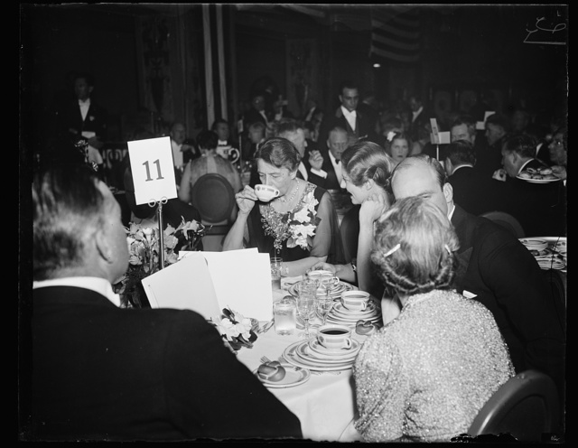 FIRST LADY ATTENDS FARLEY DINNER. WASHINGTON, D.C. FEBRUARY 16. MRS. FRANKLIN D. ROOSEVELT SEEMS TO BE ENJOYING THE CONSOMME AT THE TESTIMONIAL DINNER GIVEN TO JAMES A FARLEY LAST NIGHT. DEMOCRATS FROM EVERY STATE IN THE UNION ATTENDED THE AFFAIR