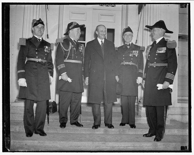 French Naval officers at White House. Washington, D.C., March 30. Officers of the French Cruiser Jeanne De Arc accompanied by the French Ambassador Georges Bonnet today paid their respects to the President at the White House. Left to right: Lt. F.M.G. Lafargue, Admiral Louis Sable, Naval Attache of the French Embassy, Ambassador Bonnett, Captain Henri Latham, in command of the cruiser, and Captain Paul Bastedo, Naval Aide to the President
