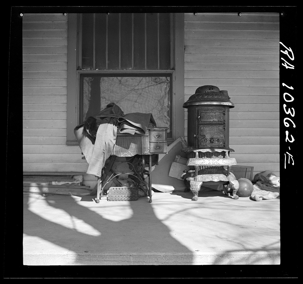 Furniture being moved out of the farmhouse of Everett Shoemaker, tenant farmer. Near Shadeland, Indiana