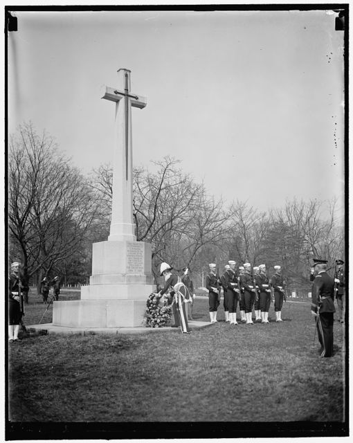 Governor General at Canadian Cross. Washington, D.C., March 31. Canada's Governor General, Lord Tweedsmuir, placing a wreath on the Canadian cross in Arlington National Cemetery today. The cross was erected by the Canadian government in honor of the American citizens who gave their lives for Canada during the World War, 3/31/1937