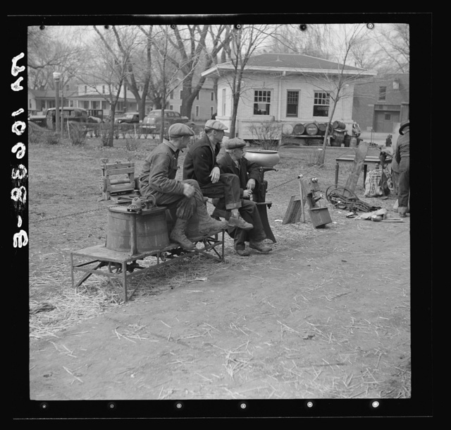 Group of farmers and articles for sale outside the sales pavilion at Aledo, Illinois