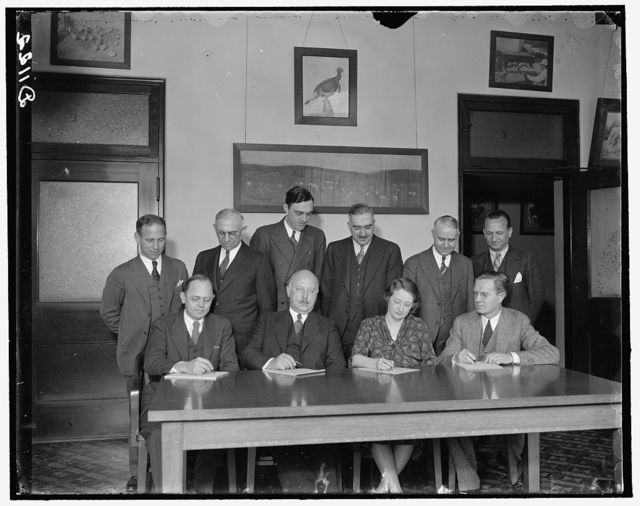 Hatchery Tribune. Standing, left to right: H.W. Marston, Office of Experiment Station; Dr. J.W.T. Duval, Commodity Exchange Adm.; E.G. Moore; Dr. H.C. McPhee; Roy C. Potts and Dr. Moskey. Seated, left to right: Mr. Beverly Winton, Bureau of Animal Industry; Dr. J.R. Mohler, Chief of Bu. of Animal Ind.; Dr. Florence King. Bureau of Home Economics; W.D. Termohlen. Agr. Adjustment Adm., 3/22/1937