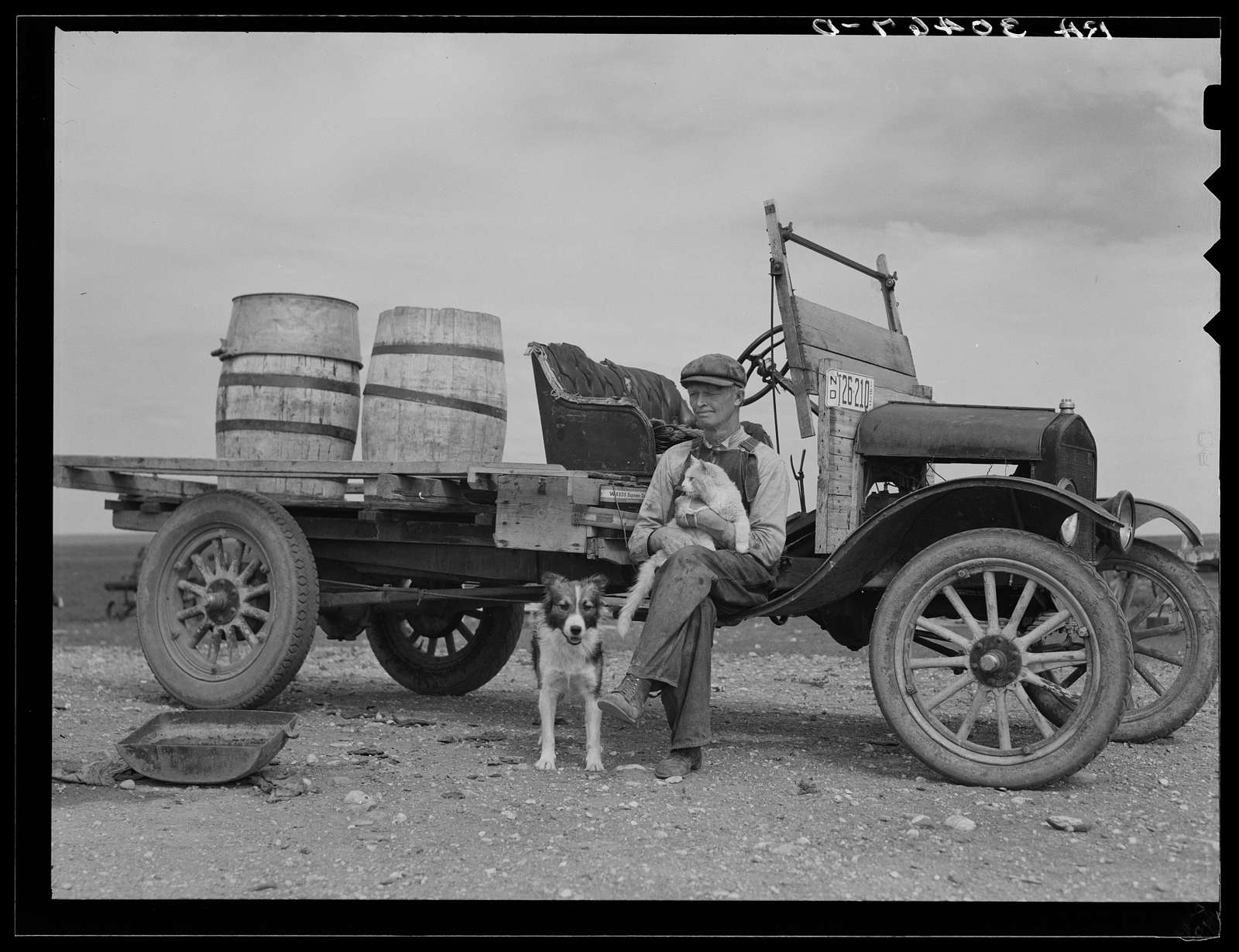 Herman Gerling. Barrels on truck are for hauling water. Near Wheelock, North Dakota