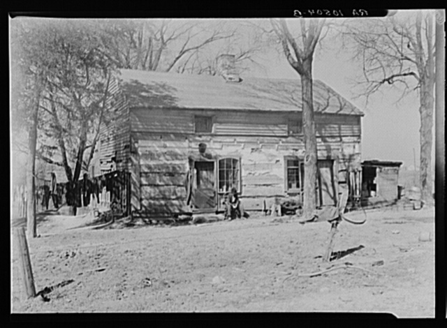 House on the farm rented by Erasty Emvich. Near Battlefield, Indiana. Emvich repaired this house at his own expense when he moved in. There were no windows or doors and the roof had holes three feet wide. He also built a barn, dug a fruit cellar, and put in one hundred rods of fence--all at his own expense. He has now been advised by the landlord that he must leave this year
