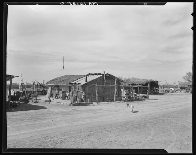 Housing typical of that afforded Mexican field workers of the Imperial Valley. These people are not migrants, but live on the edge of the ranches and work in peas and melons