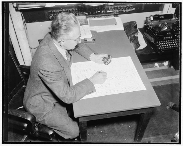 """How a bill become a law. After discussion and debate on the merits and defects of the bill as presented or amended, a vote is taken either by """"aye & nay"""", tellers, or tally. This picture shows Hans Jurgensen, tally clerk of the house recording the results of a tally vote"""