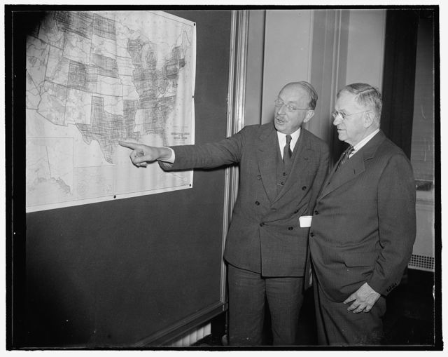 Interior Secretary and his choice for federal housing post. Washington, D.C., Sept. 20. Following a meeting today with housing experts from all parts of the country, Secretary of Interior Harold Ickes views a a map showing the location of the many low-cost housing projects now under way. Dr. Howard A. Gray, head of the PWA Housing Administration and Ickes' choice for the newly created $10,000 post as administrator of the U.S. Housing Authority, points out the locations to the secretary. Today's meeting was called to discuss the operation of the $500,000,000 Wagner Housing Act. 9/20/37