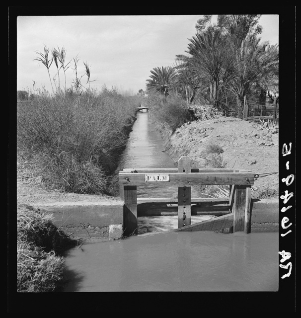 Irrigation ditch along the road. Imperial Valley, California
