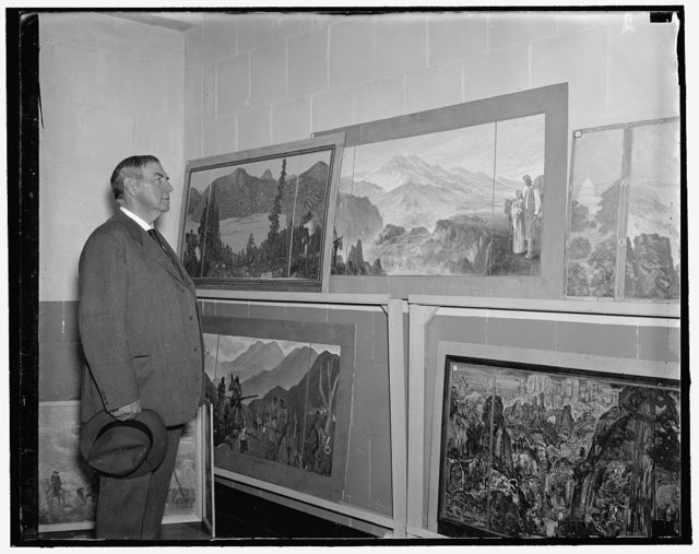 Justice Stone looks over the mural. Washington, D.C., May 3. Justice Harlan F. Stone, of the U.S. Supreme Court was an interested spectator at the mural exhibition which is nation-wide. These sketches of murals are to be judged by prominent artists to decide who will do the murals in the new Dept. of Interior. Besides the promise of the job of doing the walls in the Interior Dept. auditorium, there are cash prizes of $5,500, 5/3/1937
