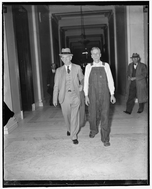 Kentucky Bomber & U.S. Marshall. Washington, D.C., April 14. Richard C. Tackett, (right) who is appearing before the Senate Civil Liberties Committee testifying that he is one of the three that bombed a union organizer in Harlan County, Ky., is shown in the custody of U.S. Deputy Marshall Robert H. Bonham of Washington, D.C. (left). Tackett is in custody of the Marshall during the hearing and is now residing in the district jail, 4/15/1937