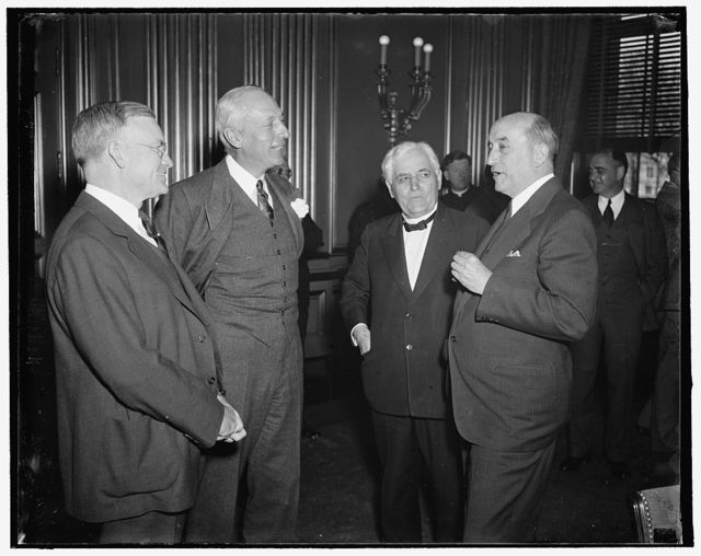 Labor and industrial leaders get together. Washington, D.C., May 4. Leaders of labor and industry pictured as they met today at the Labor Department shortly before the conference called by Secretary Perkins convened. prominent figures in labor and industry attended the meeting in efforts to develop a formula for averting strikes and lockouts. Left to right: George H. Davis, new President of the U.S. Chamber of Commerce; Harper Sibley, past President of the Chamber; Frank Morrison, Secretary of the American Federation of Labor; and Edward F. McGrady, Assistant Secretary of Labor, 5/4/1937