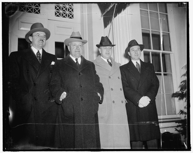 Left to right: Ernest Kanzler, Universal Credit Co.; Henry Ittleson, Commercial Investment Trust; Senator Prentiss Brown, of Mich.; Edsel Ford, Auto Conference at White House