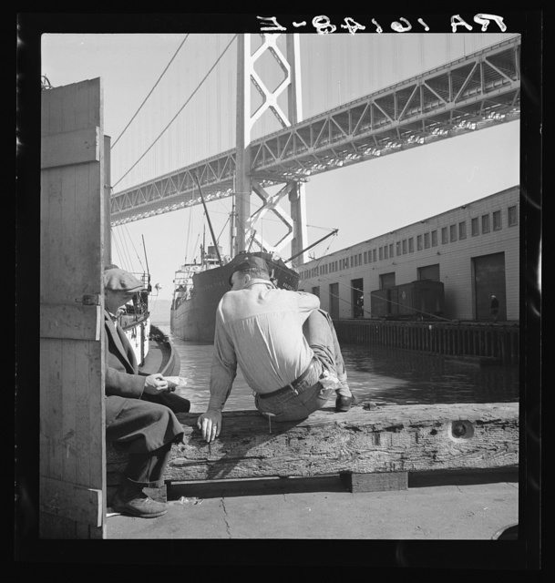 Longshoremen's lunch hour. San Francisco waterfront. California