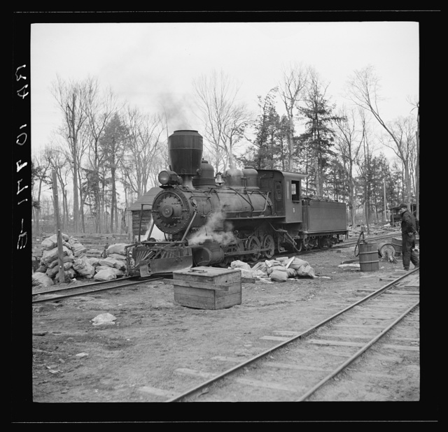 Lumber camp locomotive. Forest County, Wisconsin. Note special smokestack to catch sparks
