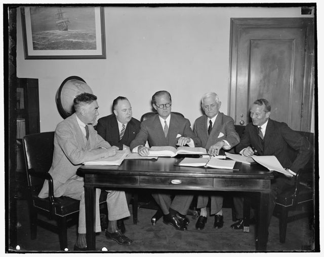 Maritime board holds first conference. Washington, D.C., April 16. The Maritime Commission which was just confirmed by the Senate yesterday met this morning for their first conference. This is the permanent Commission. Left to right: Thomas M. Woodward; Edawrd C. Moran, Jr.; Chairman Joseph P. Kennedy; Rear Admirals Henry A. Wiley, and Emory S. Land, 4/16/1937