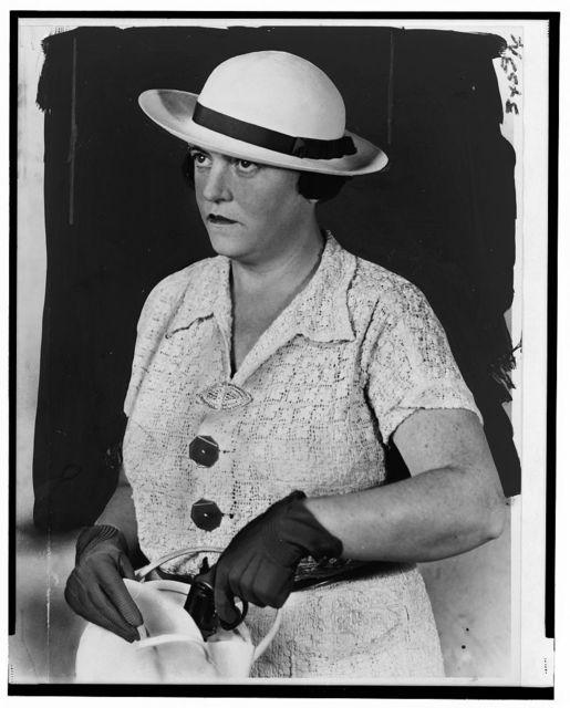 [Mary Agnes Shanley, New York City detective, half-length portrait, facing left, pulling a pistol out of her handbag]