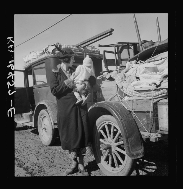 Mexican child. She helps tie carrots in the field. Coachella Valley, California