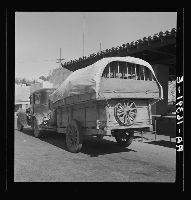 Migrant family stopped at the California-Arizona state line to have their baggage inspected for plant pests. Yuma, Arizona