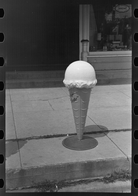 Model of ice cream cone in front of candy store, Sun Prairie, Wisconsin