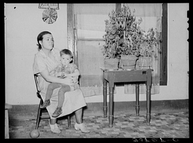 Mother and child in home near Williston, North Dakota