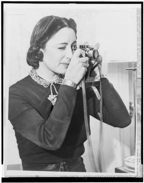 [Mrs. Rose Covarrubias, half-length portrait, with camera] / World-Telegram staff photo.