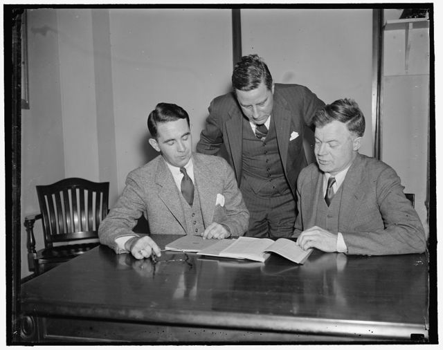 National Labor Relations Board. Washington, D.C., April 14. The National Labor Relations Board pouring over some of their problems left to right: Wakefield Smith, Edwin S. Smith, and the Chairman J. Warren Madden, 4/14/1937