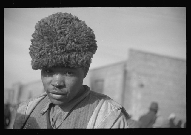 Negro with a fur cap, a flood refugee in the camp at Forrest City, Arkansas