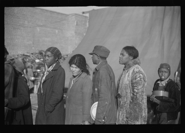 Negroes at mealtime in the flood refugee camp, Forrest City, Arkansas