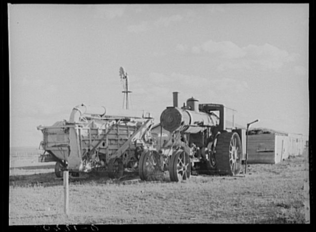 Old steam tractor and threshing machine, idle for nine years. Ellisville Township, Williams County, North Dakota