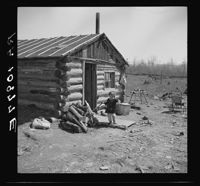 One of the Bodray children in front of the family home near Tipler, Wisconsin