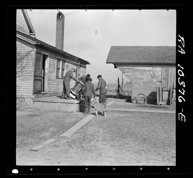 One of the last articles to be moved from the house during the moving operations of Everett Shoemaker, tenant farmer. Near Shadeland, Indiana