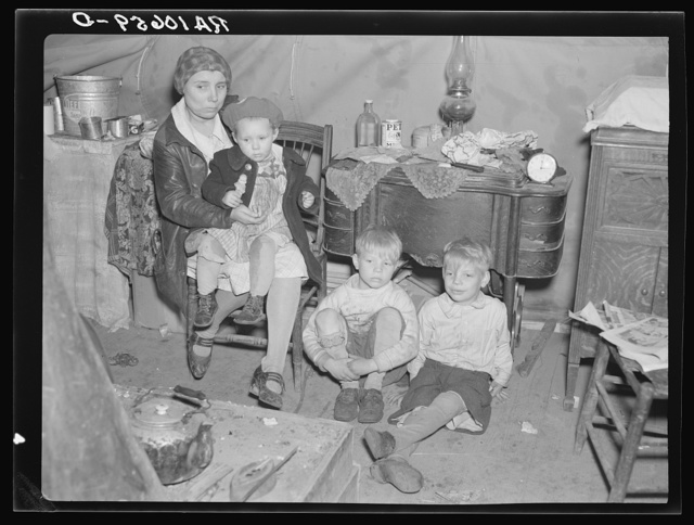 Part of flood refugee family in a tent at Tent City, near Shawneetown, Illinois