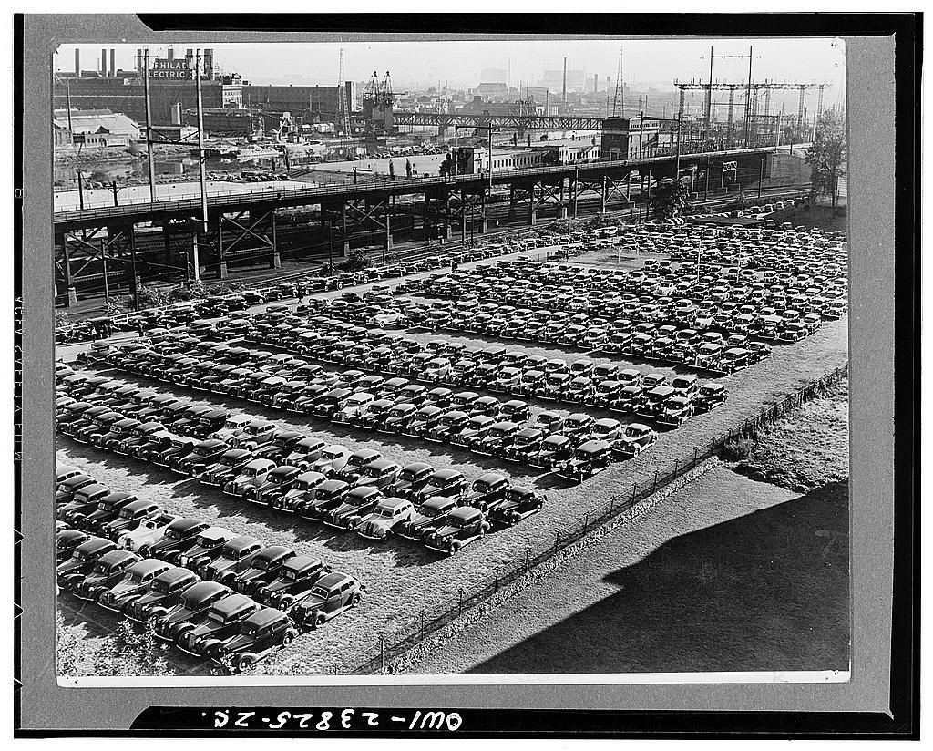 Philadelphia, Pennsylvania. Cars parked in outdoor lot in industrial section