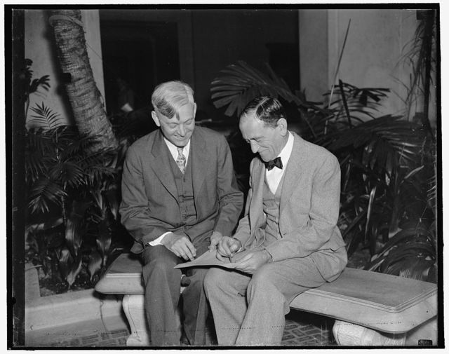 Plan Pan American Exposition. Washington, D.C., April 17. Dr. Roscoe R. Hill (left) former economic advisor to Latin-America for the State Dept. has just completed a 17,000 mile air trip to the capitals of the 16 Latin American nations to find out the plans and the participations of the countries at the Pan American Exposition which is to open in Dallas, Texas this June. Dr. Hill is shown going over some of the plans with Dr. L.S. Rowe (right) who is the Director General of the Pan American Union, 4/16/1937
