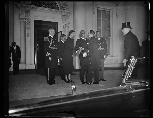 PRESIDENT AND MRS. ROOSEVELT GREET GOVERNOR GENERAL OF CANADA AT WHITE HOUSE. WASHINGTON, D.C., MARCH 30. PRESIDENT AND MRS. ROOSEVELT EXTENDING A WARM GREETING TO THE GOVERNOR GENERAL OF CANADA LORD TWEEDSMUIR AS HE ARRIVED AT THE WHITE HOUSE TODAY FOR A FEW DAYS. LORD AND LADY TWEEDSMUIR ARE IN WASHINGTON TO REPAY THE VISIT OF PRESIDENT ROOSEVELT TO CANADA LAST SUMMER. IN THE PHOTOGRAPH, L TO R: CAPT. PAUL BASTEDO, WHITE HOUSE NAVAL AIDE; MRS. ROOSEVELT; PRESIDENT ROOSEVELT; GOVERNOR GENERAL TWEEDSMUIR; AND COL. E.M. WATSON, WHITE HOUSE MILITARY AIDE