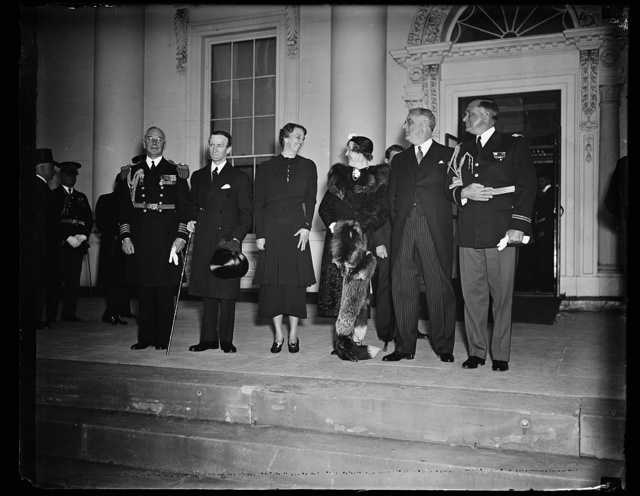 PRESIDENT AND MRS. ROOSEVELT WELCOME GOVERNOR GENERAL OF CANADA AND LADY TWEEDSMUIR. WASHINGTON, MARCH 30. A WELCOME USUALLY RESERVED FOR ROYALTY WAS ACCORDED THE GOVERNOR GENERAL OF CANADA AND LADY TWEEDSMUIR BY PRESIDENT AND MRS. ROOSEVELT TODAY AS THEY ARRIVED AT THE WHITE HOUSE FOR A SHORT VISIT. PERSONAL REPRESENTATIVE OF KING GEORGE VI IN CANADA THE GOVERNOR GENERAL IS HERE TO REPAY THE VISIT OF PRESIDENT ROOSEVELT TO CANADA LAST SUMMER. IN THE PHOTOGRAPH, L TO R: CAPT. PAUL BASTEDO, WHITE HOUSE NAVAL AIDE; LORD TWEEDSMUIR; MRS. ROOSEVELT; LADY TWEEDSMUIR; PRESIDENT ROOSEVELT; AND COL. E.M. WATSON, WHITE HOUSE MILITARY AIDE
