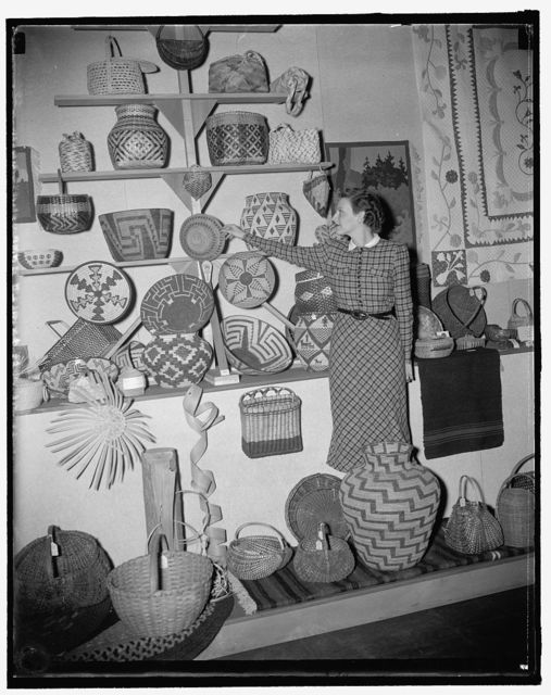 Rural art exhibit at the Department of Agriculture. Miss Marjorie Bonham, with baskets, hand woven