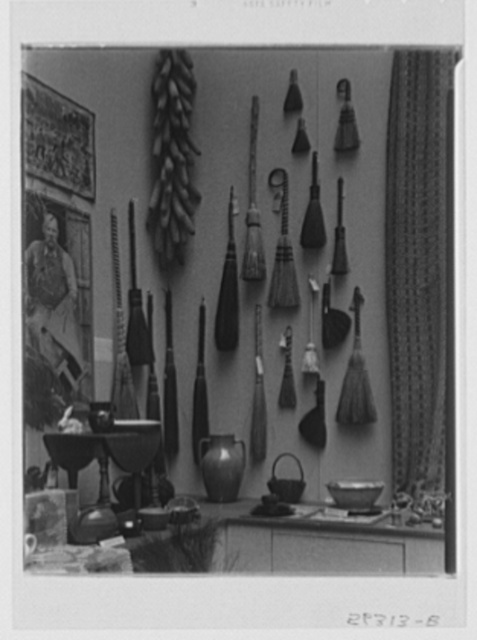Rural arts exhibition held under the auspices of the Farm Security Administration (FSA) in the patio of the U.S. Department of Agriculture building. Hearth brooms from Southern Highlands; wall hanging from Delaware; table from New Hampshire; pottery from Piedmont, North Carolina, section and New Hampshire; photograph of Southern Highlands tanner by Doris Ulmann; woven rug from New Hope, Pennsylvania