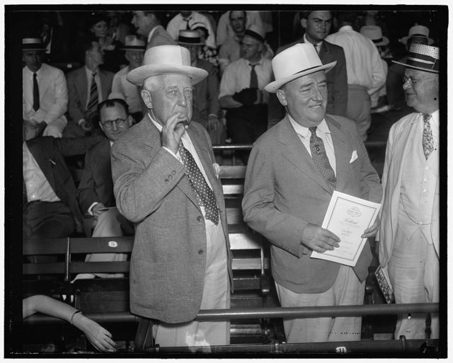 School out for legislators. Washington D.C., July 7. Capitol Hill was deserted today as the House and Senate recessed to enable the legislators to view the 1937 All-Star Game, here we see, Rep. Bertram N. Snell (left) Republic Minority Leader; and Rep. John J. O'Connor, Chairman of the House Rules Committee, 7/7/37