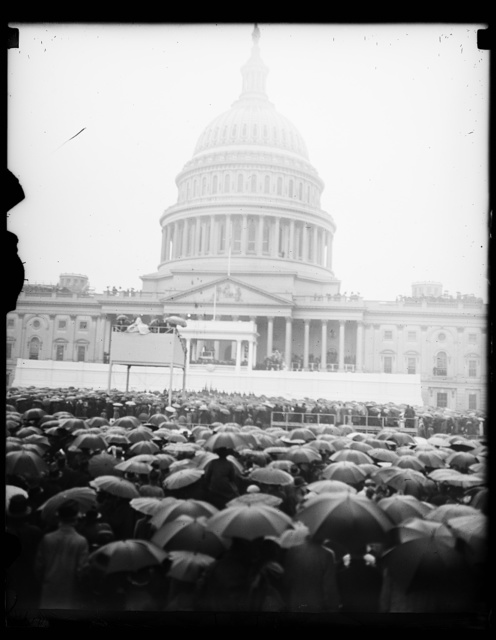 SEA OF UMBRELLAS, WASHINGTON, D.C. JANUARY 20. PRESIDENT ROOSEVELT FACED A VERITABLE SEA OF UMBRELLAS AS HE TOOK HIS SECOND OATH OF OFFICE AND DELIVERED HIS INAUGURAL ADDRESS AT THE CAPITOL TODAY. THOUSANDS BRAVED THE CHILL RAIN TO WITNESS THE CEREMONY