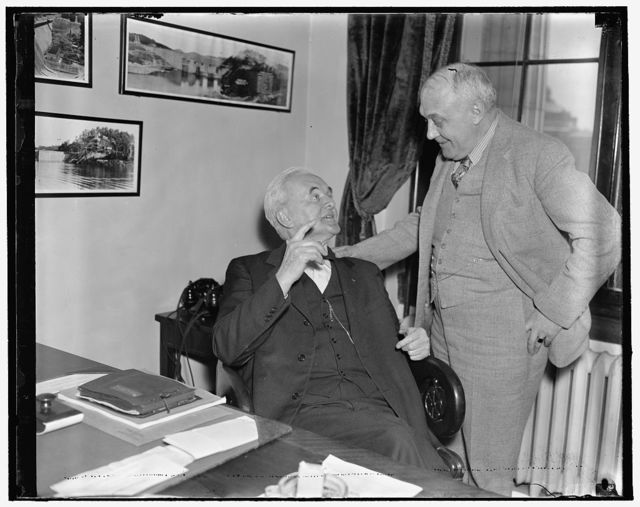Sen. Norris & Rep. Knutson. Washington, D.C., April 7. Two members of Congress who voted against the bill for the World War are shown going over old times. Left to right: Senator George Norris of Neb. and Representative Harold Knutson of Minn., 4/7/1937