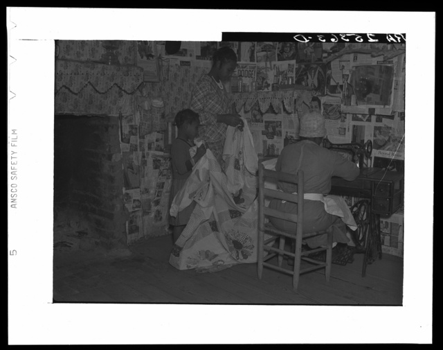 Sewing a quilt. Gees Bend, Alabama