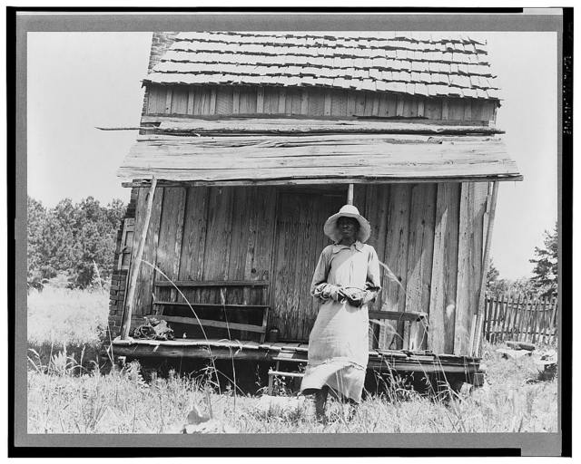 Sharecropper's cabin and sharecropper's wife. Ten miles south of Jackson, Mississippi