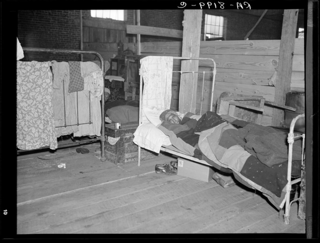 Sick flood refugee in the Red Cross temporary infirmary at Forrest City, Arkansas