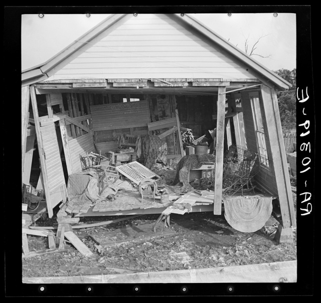 Side of house torn away by flood, showing damaged interior of house. Black Township, Posey County, Indiana